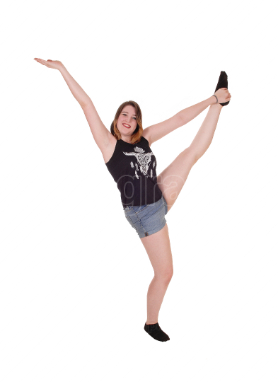 Dancing young woman in shorts in the studio