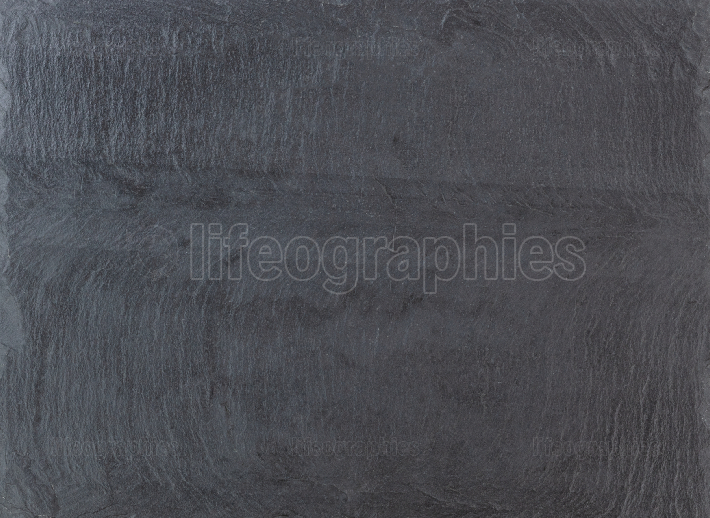 Dark grey black natural stone slate textured background