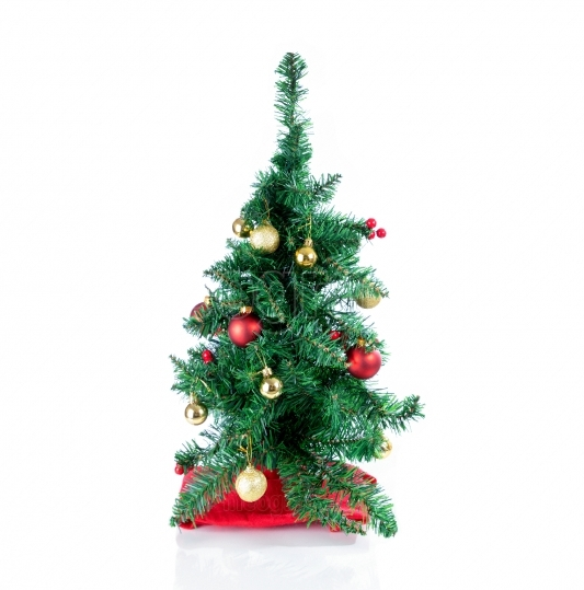 Decorated Christmas tree isolated on a white background setting