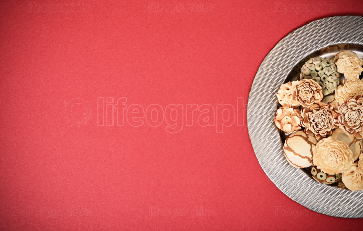 Decorative bowl with ornaments on red background