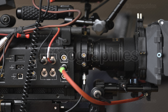 Details from a 5k cinema production camera and setup. Various devices, as sound, follow focus, optical lenses, cables, microphones, headphones, monitors, led light sources, etc