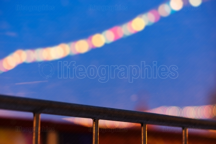 Diagonal border with new year illumination on red square bokeh b