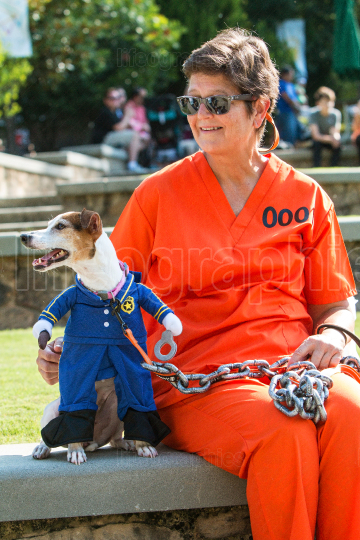Dog Wearing Prison Guard Costume Is Chained To Female Owner