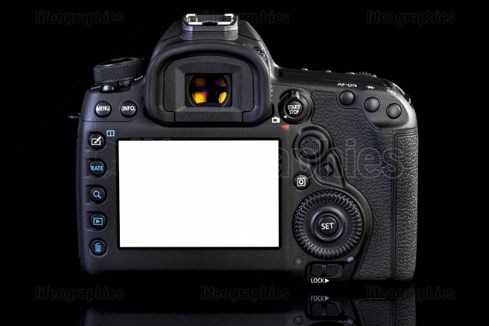 DSLR camera on black glass background