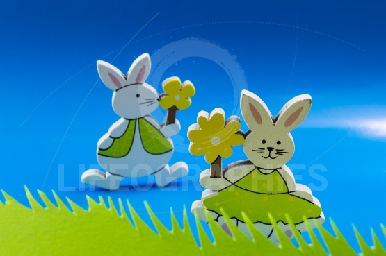 Easter bunnies on blue background