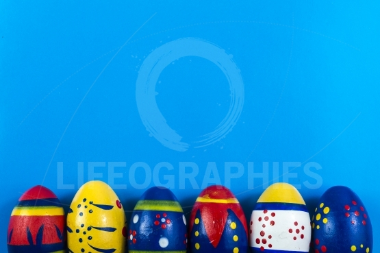 Easter colored eggs on blue background