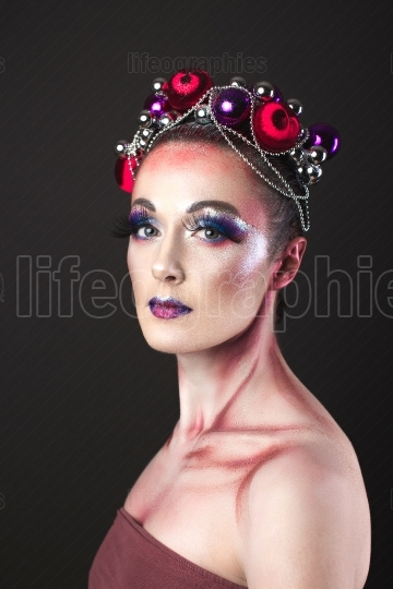 Elegant Model with Bright New Year s Eve Make up in a Wreath of