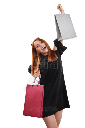 Excited and happy young woman with shopping bags