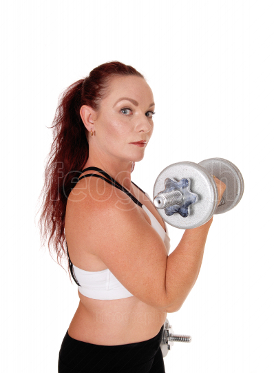 Exercising woman with her dumbbell lifting