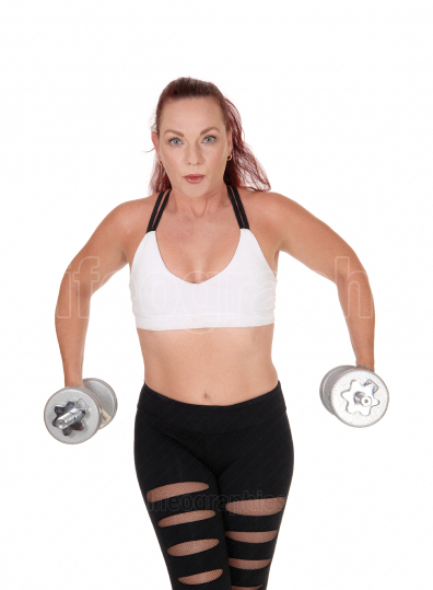 Exercising woman with her dumbbells lifting