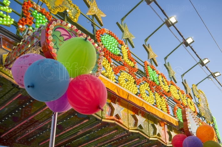 Fairground attraction front plenty of bulbs, leds, balloons and