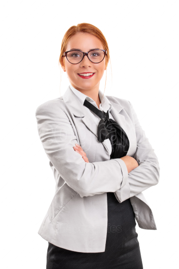 Fashionable businesswoman in a suit with folded arms