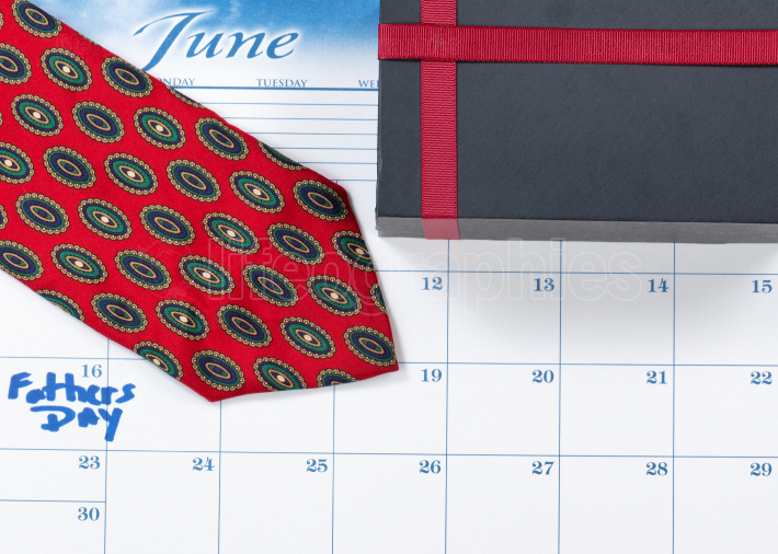 Fathers Day holiday marked on calendar with gift box surprise