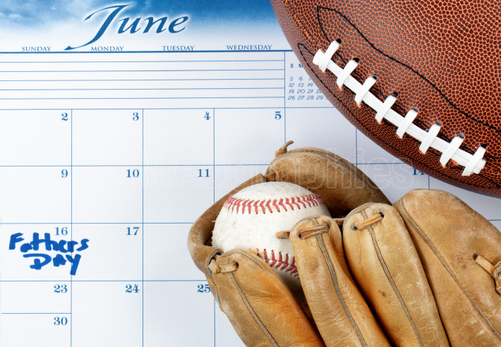 Fathers Day holiday marked on calendar with sports equipment