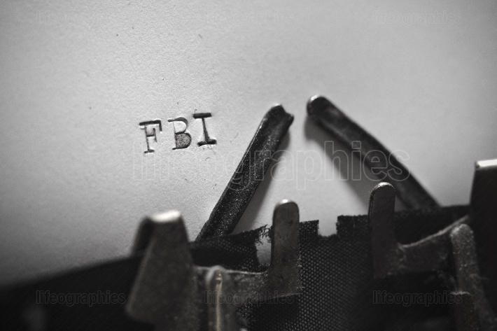 FBI typed words on a Vintage Typewriter.