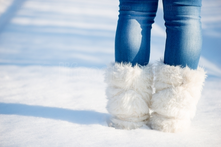 Feet of a woman in snow