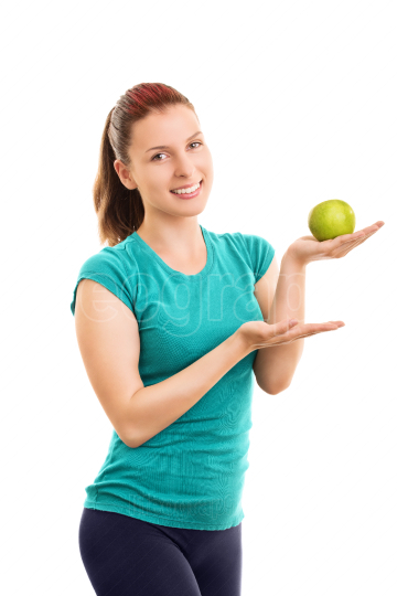 Female athlete holding a green apple
