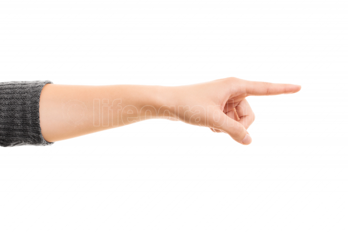 Female hand pointing to a direction