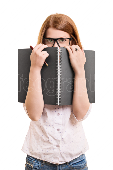 Female student hiding behind her book
