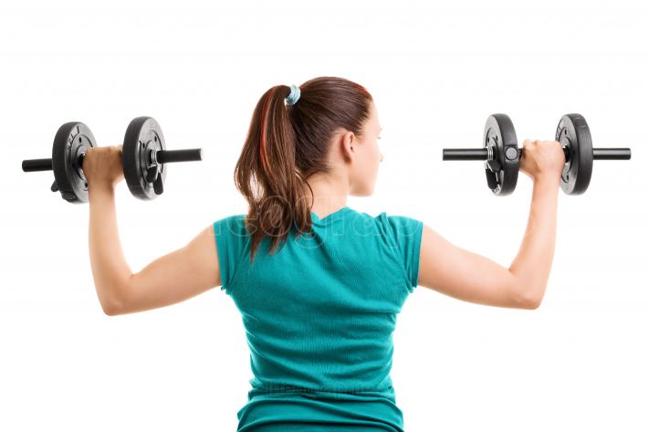 Fit young girl holding dumbbells