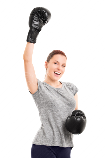 Fit young girl with boxing gloves cheering
