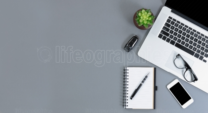 Flat lay view of gray desk with amply copy space