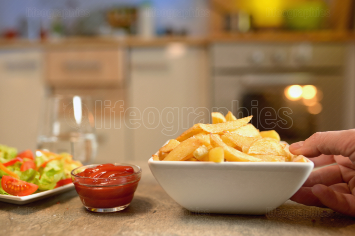 French fries and salad on table