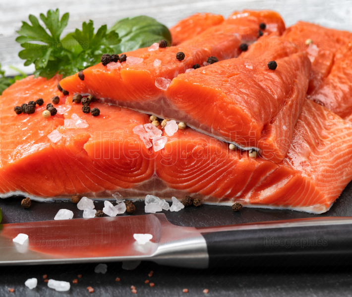 Fresh raw pacific wild king salmon fillets on natural stone with