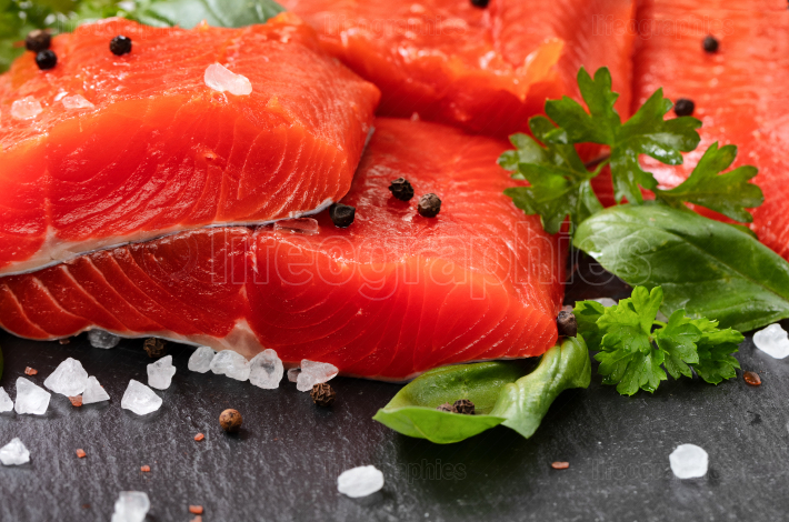 Fresh raw pacific wild sockeye salmon fillets on natural stone w