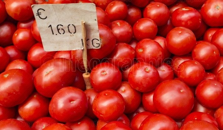Fresh tomatoes in a market stall.