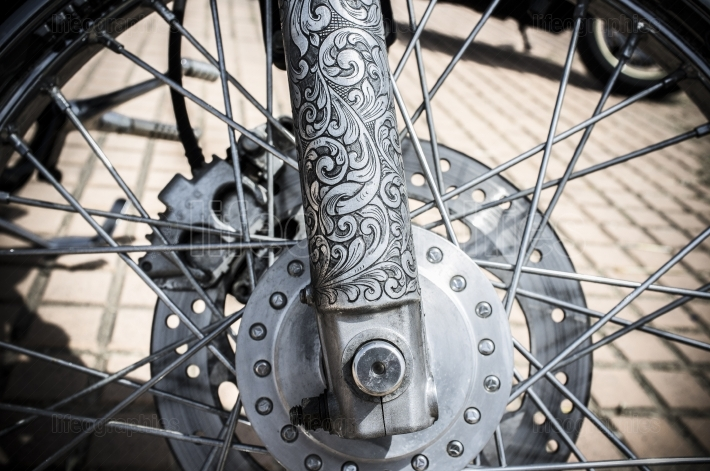 Front fork decorated with tattoo motifs of a motorbike