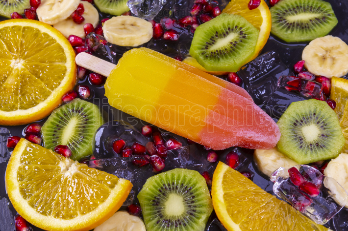 Fruit ice cream on stick with slices fruits