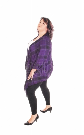 Full figured woman standing in profile