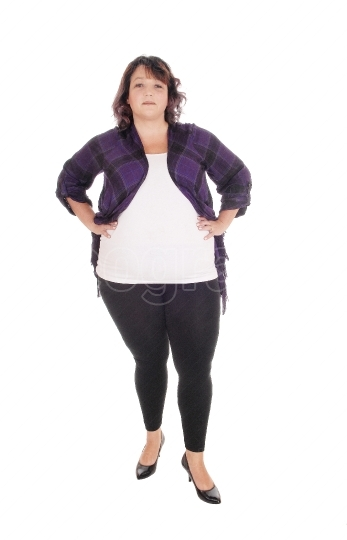 Full figured woman standing in tights