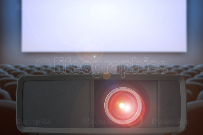 FULL HD Video projector with high precision lens and lens flare. Cinema hall generated in background.