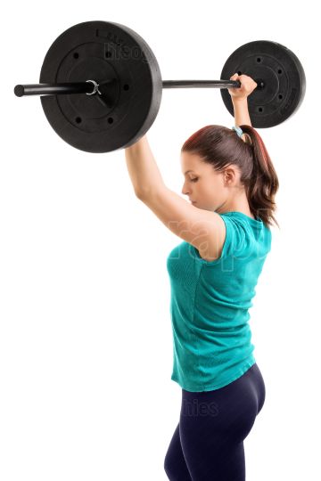 Girl holding weights up