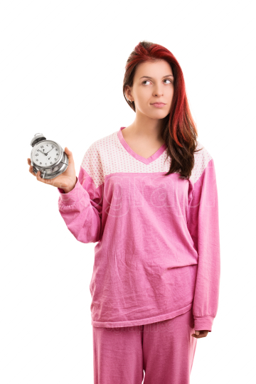 Girl in pajamas annoyed that overslept again