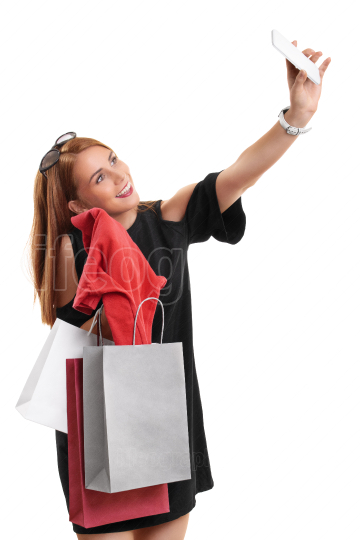 Girl taking a selfie with her shopping bags