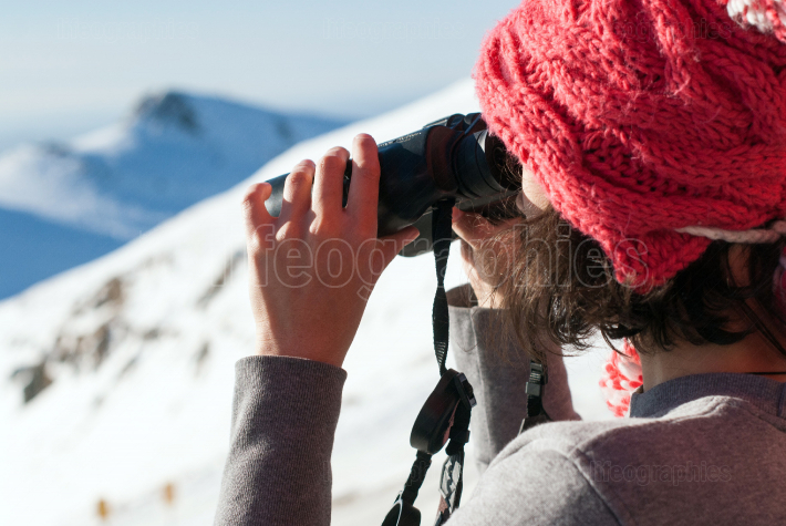 Girl using binocular