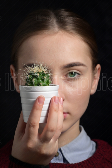 Girl With A Small Cactus