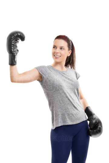 Girl with boxing gloves raising hand in celebration