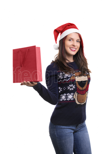 Girl with Santa s hat and a shopping bag