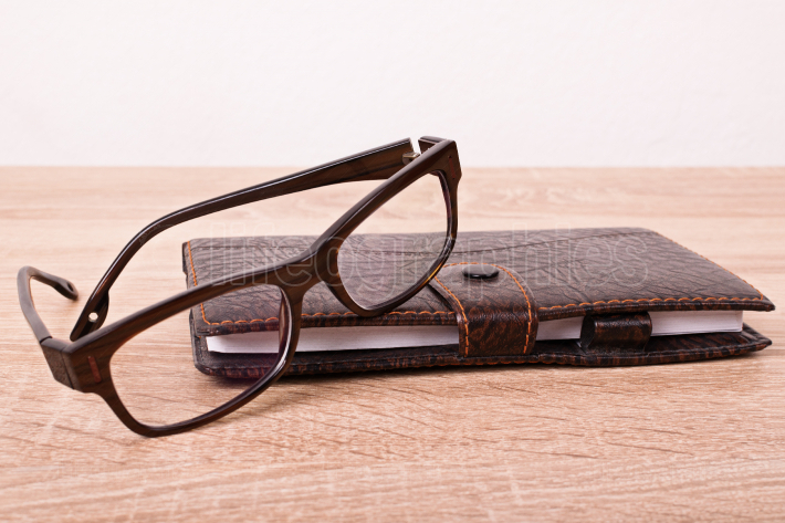 Glasses and a notebook on a table