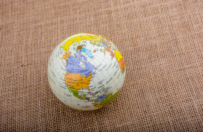 Globe on a brown fabric background