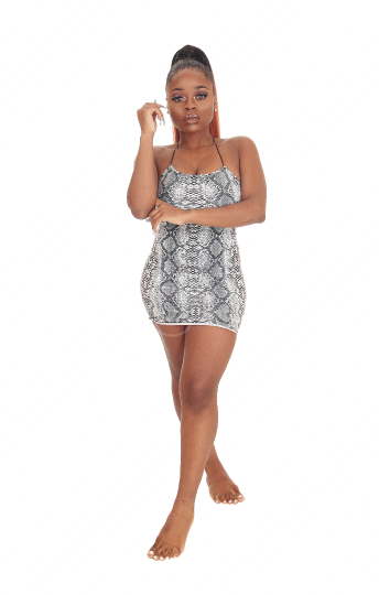 Gorgeous African woman standing in a short dress
