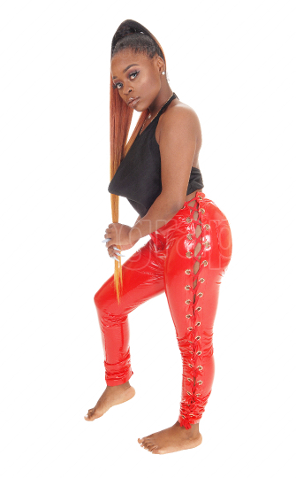 Gorgeous African woman standing in red latex pants