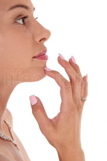 Gorgeous face of a young woman, finger on chin
