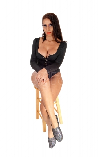 Gorgeous woman sitting in black body suit