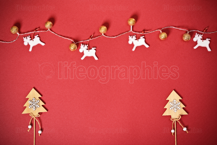 Greeting card concept with Christmas trees, lights and reindeer