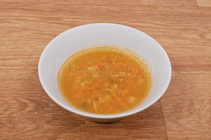 Groat soup with vegetables on a table